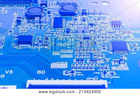 Circuit board with resistors microchips and electronic components. Electronic computer hardware technology. Integrated communication processor. Information engineering component. Semiconductor. PCB.