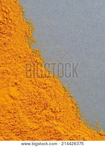 Turmeric Powder or Curcuma longa on gray background. Top view. Copy space for text.