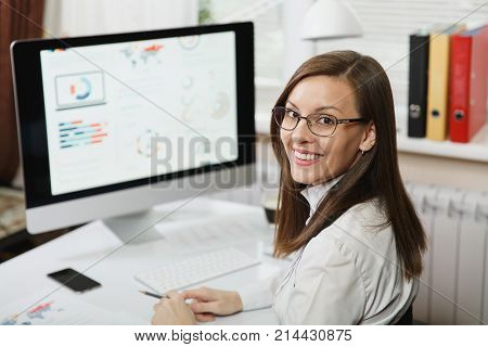 Beautiful Smiling Brown-hair Business Woman In Suit And Glasses Working At Computer With Documents I