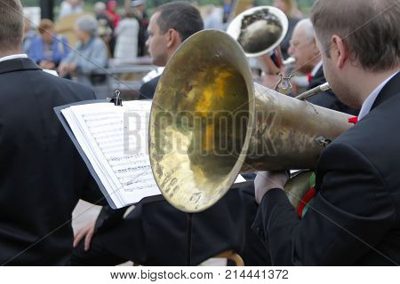 Belarus GomelJuly 3 2017 Independence Day of the Republic of BelarusCity ParkThe musician plays the trumpet.Play on the trumpet.