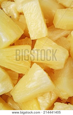 Pineapple slices as background. Yellow pineapples texture pattern. Photo.
