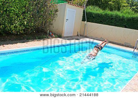 Man Jumping To Swimming Pool