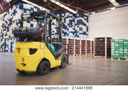 interior of large modern warehouse with forklifts.Industry concept.