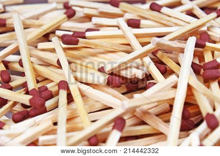 Match sticks with brown heads in a row. Fire Matches texture pattern concept. Stacked matches as background photo.