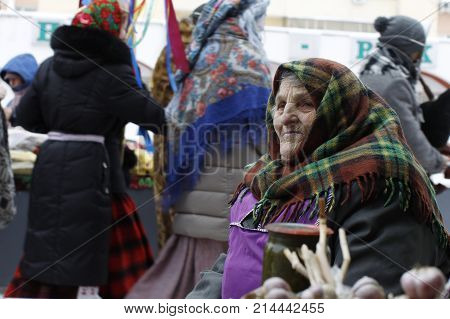 Belarus, Gomel, January 13, 2017. Central Market.an Old Russian Woman In A Winter Kerchief. An Old P
