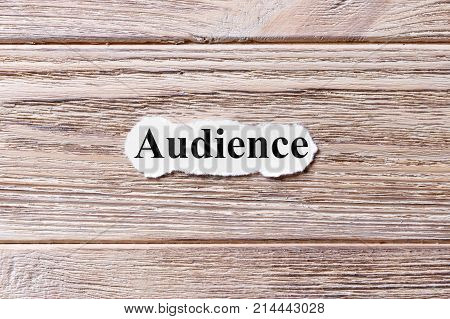 AUDIENCE of the word on paper. concept. Words of AUDIENCE on a wooden background.