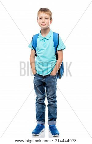 Portrait Of A Schoolboy In Full Length On A White Background In Studio