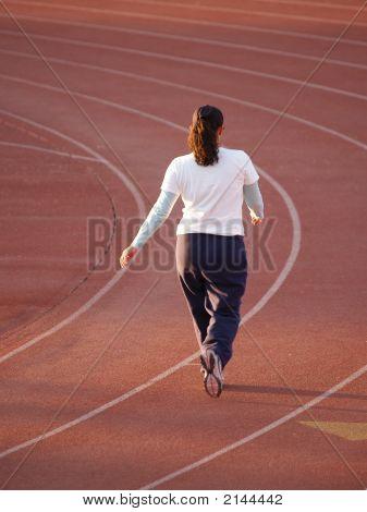 Woman Walking On Track