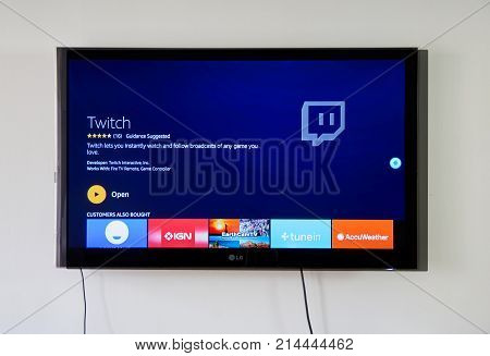 MONTREAL CANADA - NOVEMBER 15 2017: Twitch app and logo on LG TV. Twitch is a live streaming video platform owned by Twitch Interactive a subsidiary of Amazon.com