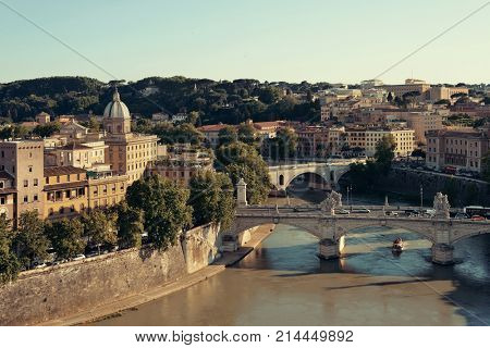 Rome aerial view with ancient architecture, bridge and River Tiber in Italy.