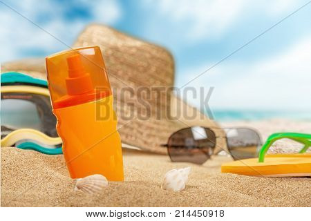 Bottle lotion sunscreen straw hat background holiday travel