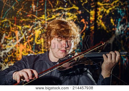 Red-haired Freckled Boy Playing Violin With Different Emotions On His Face