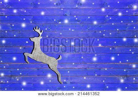 Iron dear on weathered blue wooden board