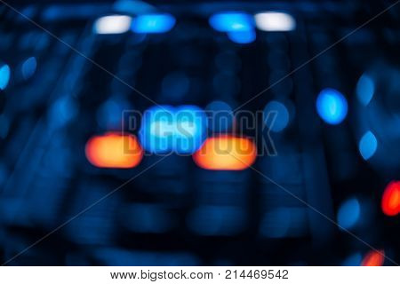 blurred glowing button, mixer DJ for mixing and controlling music in a nightclub