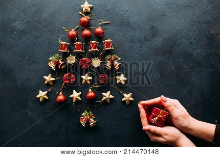 christmas toys assortment tree creative holiday on dark background. cheap gift option. handmade decoration for new year, christmas and other winter occasions