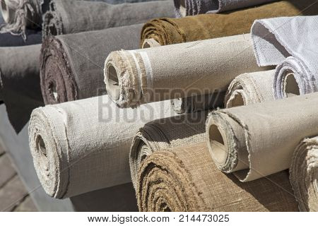 Rolls Of Linen Canvas Textile On Market Stall