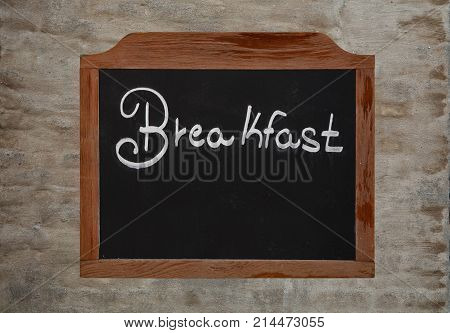Chalk Word Breakfast On Vintage Blackboard On Wall