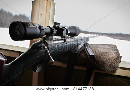 Closeup Of A Rifle Bolt And Scope While Hunting