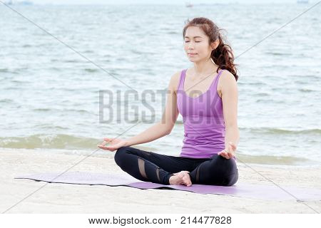 Young healthy asia woman practicing yoga on the beach healthy lifestyles wellness well being