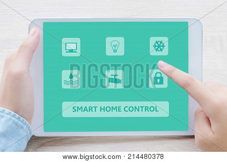 Hand using digital tablet as smart home control application on screen background smart home concept the internet of things