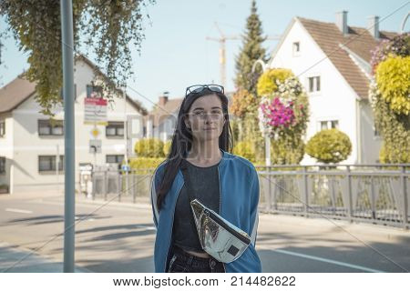 Portrait Of A Girl With Glasses On Her Head. Beautiful Girl With Glasses. The Girl In The Street Of