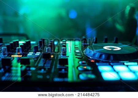 supervisors and regulators music mixer DJ to play music with blurred green background