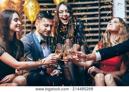 Cheers! Group Of Friends Clinking Glasses Of Champagne During Party Celebration