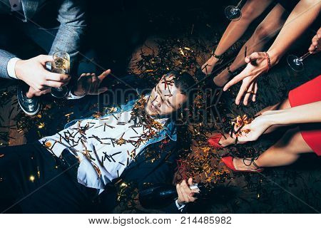 Crazy party. Drunk man lying on floor. New year Birthday Holiday Event concept