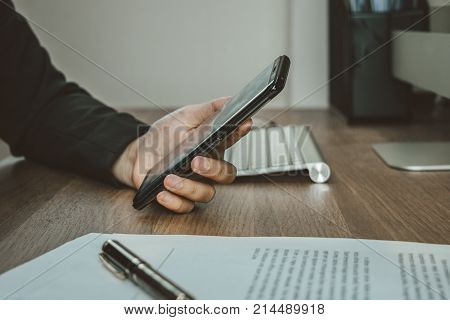 Business Woman Use Smartphone For Check Detail With Documents Before Signing Terms And Conditions, B