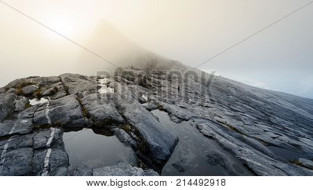 Barren rocky slopes and ponds of water on Mount Kinabalu a volcano in Borneo Malaysia.