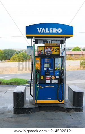 Barstow, California, USA - Oct 29, 2015 : Fuel pumps at a Valero and Diamond Shamrock gas station.