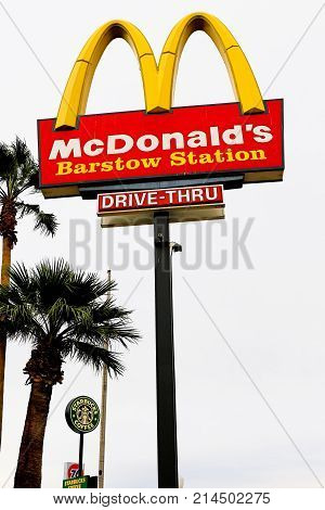 Barstow, California, USA - Oct 29, 2015: McDonald's logo on a pole. McDonald's is the world's largest chain of hamburger fast food restaurants