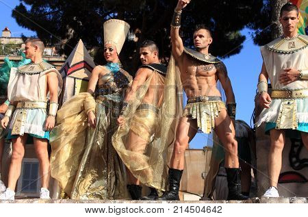 ROME - JUNE 11: Five men masked as egyptians dance on a wagon at the Rome Euro Pride Parade on June 11 2011 in Rome Italy