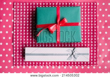 cute gift for beloved people on pink background. bright present wrapping. great surprise for birthday, fathers day, valentines day, new year, christmas, thanksgiving and other holidays.