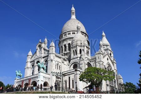 PARIS FRANCE - MAY 24: Basilica of the Sacre Coeur on May 25 2015 on Paris France. The Basilica of the Sacre Coeur is a roman catholic church located at the top Montmartre hill the highest point in Paris