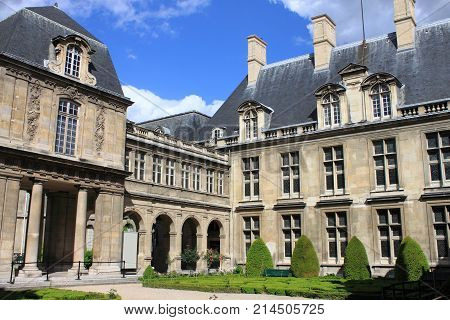 PARIS FRANCE - MAY 24 2015: Courtyard with the beautiful gardens of Carnavalet Museum. The museum was opened in 1880 and is dedicated to the history of Paris from its origins to the present day
