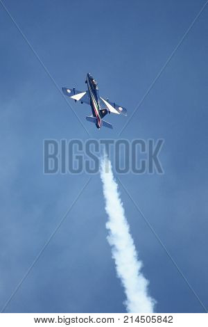 ROME - JUNE 29: A MB-339 of the italian acrobatic team Frecce Tricolori performs at the Rome International Air Show on June 29 2014 in Rome Italy