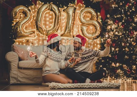 Couple Celebrating New Year At Home