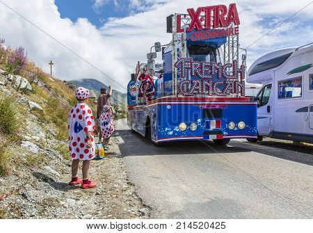 Col de la Croix de Fer France - 25 July 2015: Kids in Polka-Dot Jersey enjoying the passing of the Publicity Caravan on the road to the Col de la Croix de Fer in Alps during the stage 20 of Le Tour de France 2015.