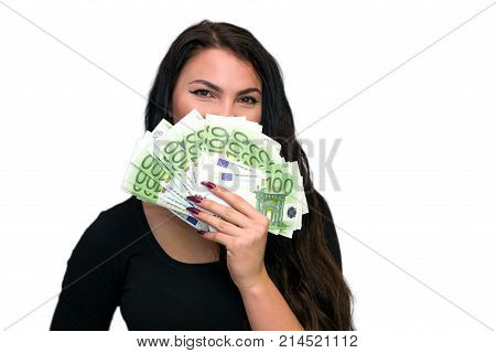 Young girl with a lot of euros in hand on white backround. Gold-digger.