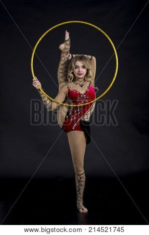 The Contortionist Girl In Stage Costume With Hoops.