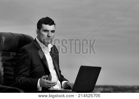 Businessman With Laptop On Chair Outdoor