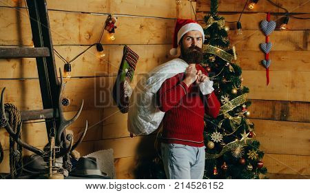 Christmas Man With Beard On Serious Face At Present Sack.