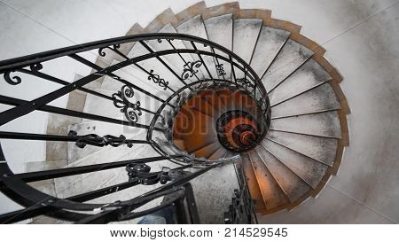 Spiral staircase in an old house. Fibonacci spiral