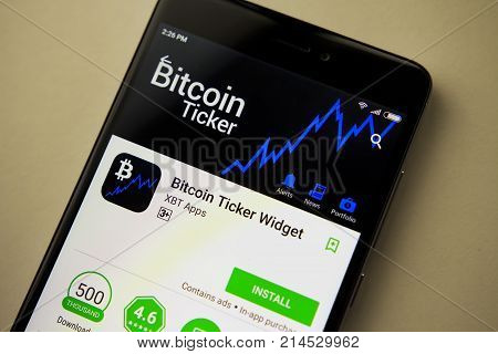 Berlin Germany - November 19 2017: Bitcoin Ticker Widget application on screen of modern smartphone close-up. Install menu of Bitcoin Ticker Widget app in Play Store.