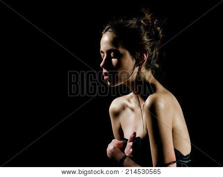 Girl With Oily Or Wet Skin On Black Background