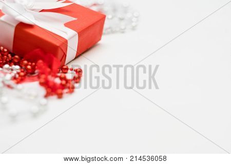 luxury jewelry present for women on white background. red closed gift box with wrapped ribbon. expensive surprise for women day, mothers day, valentines day, new year, christmas, and other holidays.