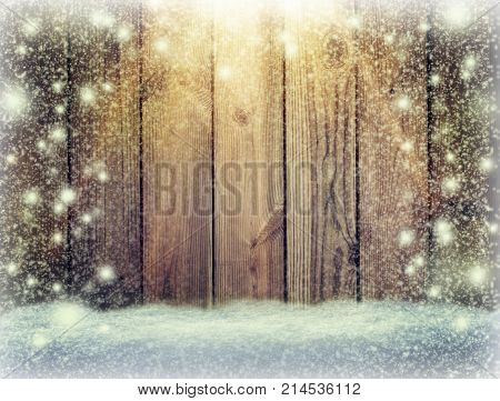 Christmas light on wooden background . Vintage Christmas decoration with lights on wooden table / Christmas table background with space for text. top view. Snowstorm.