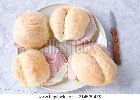 Breakfast bread rolls with ham and lettuce