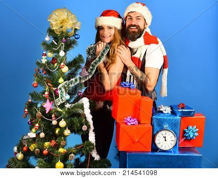 Mister And Missis Claus With Red And Blue Gifts
